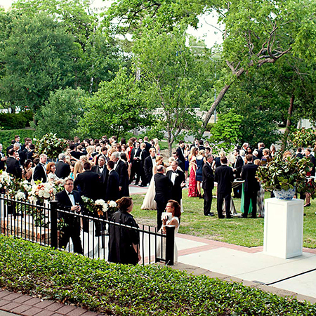 Group of people at a black tie event outside Arlington Hall