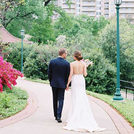 Newlywed couple walk in the park